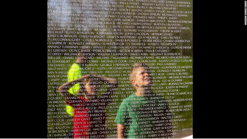 "Hussey's sons scanned names on the Vietnam Veterans Memorial during their visit to Washington, D.C. They were searching for John B. Sherman, a college friend of their grandfather's who died during the conflict. ""We tried to make everything into a lesson,"" Hussey said. ""We're trying to bring the history to life."""