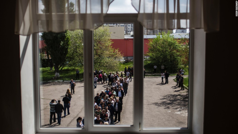 Ukrainians line up to cast their votes at a polling station in Donetsk on May 11.