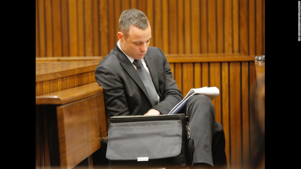 Pistorius reads notes during his trial on Monday, May 12.
