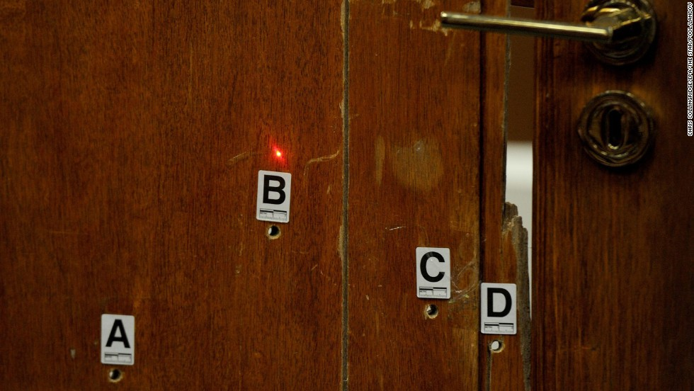 A red laser dot points at bullet holes in the bathroom door for a forensic demonstration during the trial on May 12. Pistorius admits firing four bullets through the closed door, killing Steenkamp, but says he thought he was protecting himself from a burglar.