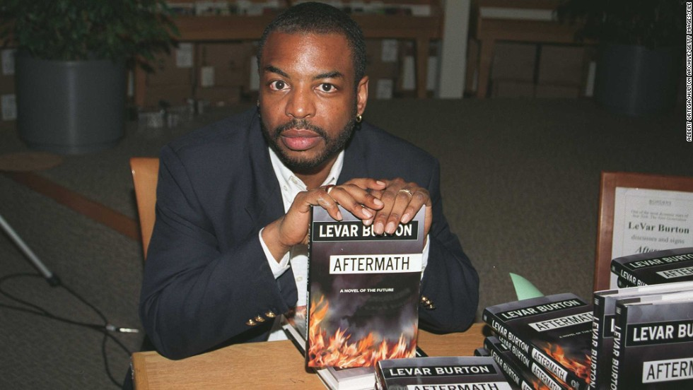 "Burton signs his sci-fi novel, ""Aftermath,"" at a Los Angeles bookstore in 1997."