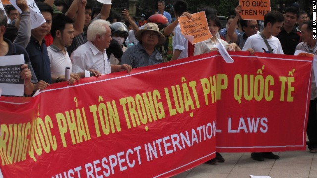 Vietnamese protesters hold a rally in Hanoi Sunday against a Chinese oil rig deployed in disputed waters of the South China Sea.