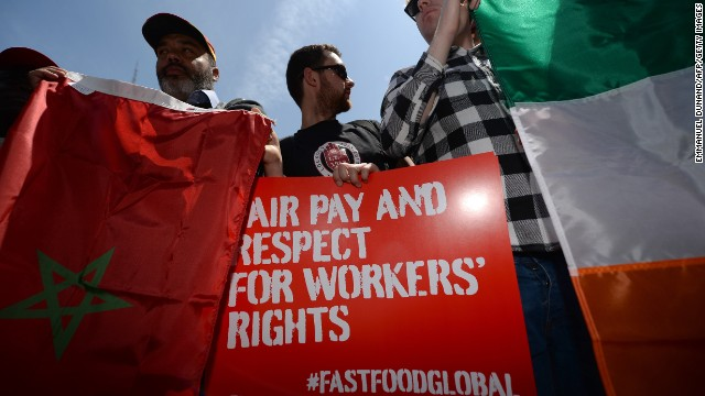 Fast-food workers from around the world stage a protest in front of a McDonald's restaurant, campaigning for higher pay, in New York, May 7, 2014. Fast-food workers from a dozen countries held a demonstration to annouce a strike in the US on May 15, 2014 and demonstration at fast-food restaurants around the world, demanding a 15 USD per hour minimum wage for workers in the US. AFP PHOTO/Emmanuel Dunand (Photo credit should read EMMANUEL DUNAND/AFP/Getty Images