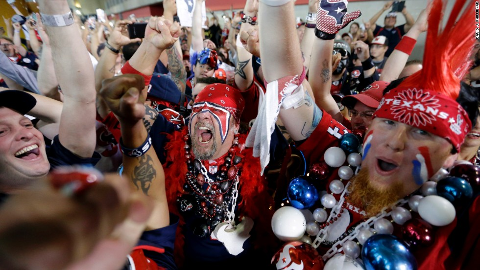 Houston Texans fans celebrate after the Texans picked South Carolina defensive end Jadeveon Clowney as the No. 1 overall pick in the NFL draft on Thursday, May 8.