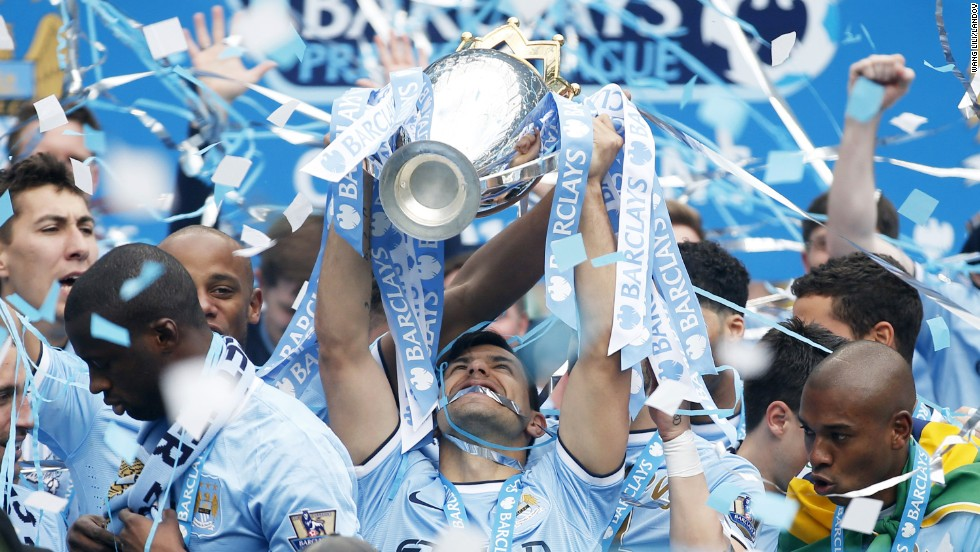 Sergio Aguero of Manchester City lifts the Premier League trophy at the end of the Barclays Premier League match between Manchester City and West Ham United at Etihad Stadium in Manchester, Britain, on Sunday, May 11. Manchester City claimed their second Premier League title in three seasons after beating West Ham United 2-0.