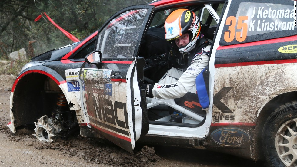 Jari Ketomaa of Finland gets out of his damaged Ford Fiesta after blowing a front tire on Friday, May 9, the first day of the FIA WRC Argentina Rally in Agua de Oro, Argentina.