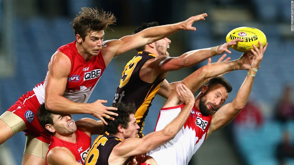 Nick Malceski and Dane Rampe of the Sydney Swans compete for the ball against Jack Gunston and Isaac Smith of the Hawthorn Hawks during an Australian Football League match in Sydney, Australia, on Friday, May 9.
