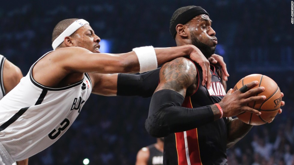 Brooklyn Nets forward Paul Pierce grabs Miami Heat forward LeBron James during Game 3 of the semifinal playoff series in New York on Saturday, May 10. Pierce was called for a flagrant foul and James scored on the play. The Nets won 104-90.