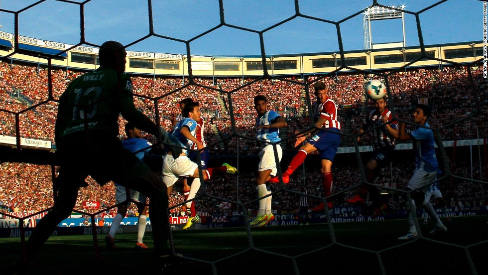 Toby Alderweireld of Atletico de Madrid scores the opening goal with a header during the La Liga match against Malaga CF at Vicente Calderon Stadium in Madrid, Spain, on Sunday, May 11.