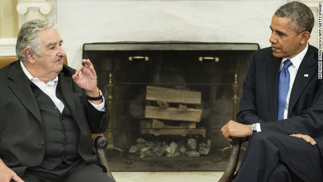 US President Barack Obama (R) listens while Uruguay President Jose Mujica Cordano makes a statement for the press before a meeting in the Oval Office of the White House May 12, 2014 in Washington, DC. AFP PHOTO/Brendan SMIALOWSKI (Photo credit should read BRENDAN SMIALOWSKI/AFP/Getty Images)