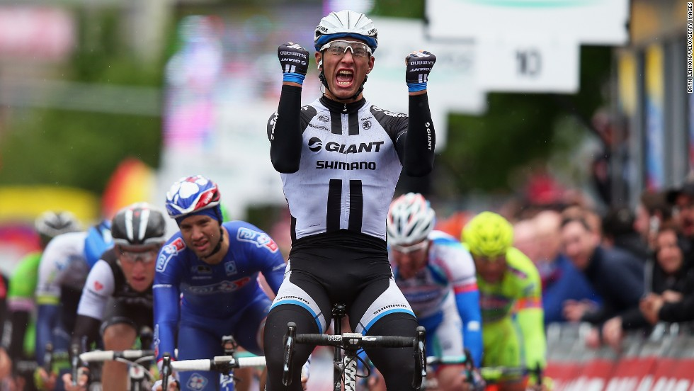 Marcel Kittel of Germany celebrates crossing the finish line to win the second stage of the 2014 Giro d'Italia in Belfast, Northern Ireland, on Saturday, May 10.