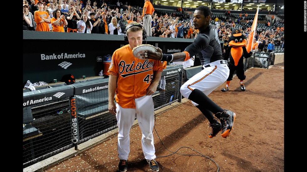 Steve Clevenger of the Baltimore Orioles is hit with a pie by Adam Jones after driving in the game-winning run in the 10th inning against the Houston Astros in Baltimore on Saturday, May 10. The Orioles won 5-4.