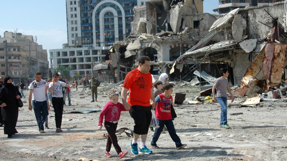 Syrians return to the Hamidiyeh, a predominantly Christian neighborhood in Homs, on Friday, May 9.