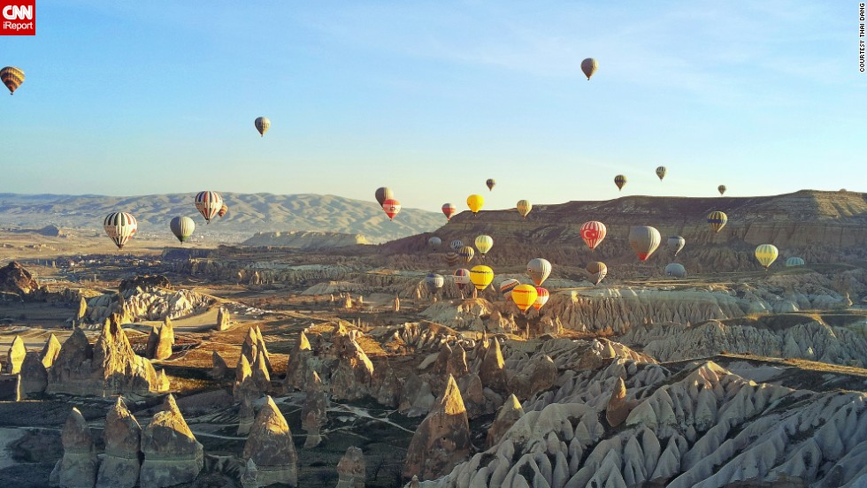 "A <a href=""http://ireport.cnn.com/docs/DOC-1112806"">hot air balloon trip</a> is a popular way to take in the stunning views of Central Turkey's <a href=""http://www.tanitma.gov.tr/TR,22529/tatil-yerleri-destinasyonlar.html"" target=""_blank"">Goreme National Park</a> and its unusual volcanic rock formations, known as ""fairy chimneys."""