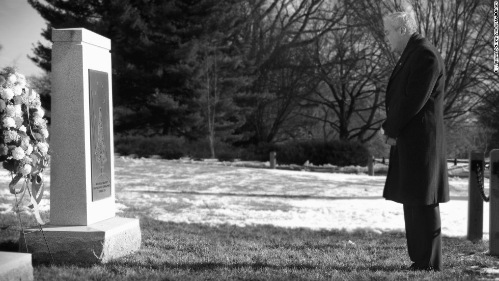 NASA Administrator Sean O'Keefe visits Arlington National Cemetery to lay a wreath honoring the crew of the Space Shuttle Columbia on February 1, 2005.
