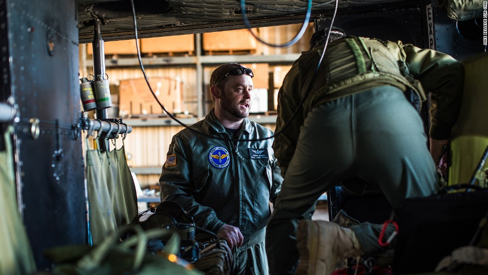 Ladon Briggs, who flew Army Black Hawk helicopters in Iraq, prepares to pilot a Huey from the Army Aviation Heritage Foundation hangar in at the Henry County Airport in Hampton, Georgia, to an air show in Columbus, Georgia on Friday, March 14. The foundation is headquartered in Hampton, where they restore retired Army helicopters in an effort to educate people about the aircraft and the people who flew them, particularly in the Vietnam War.