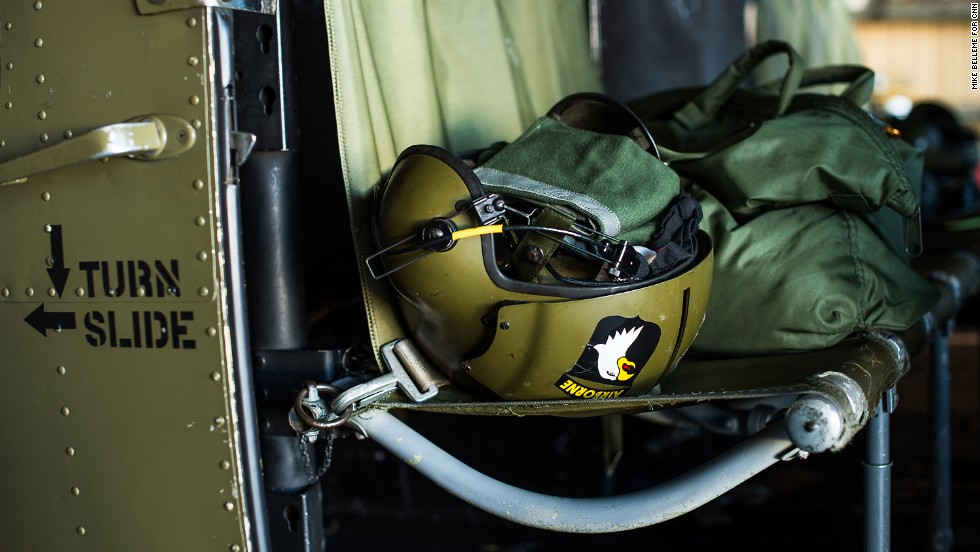 A helmet rests in the cockpit of a Huey helicopter that was in service during the war in Vietnam at the Henry County Airport.