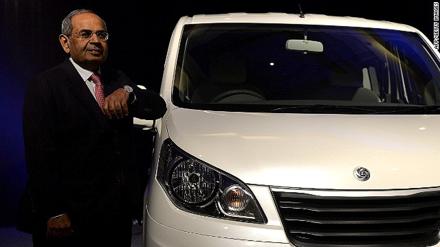 CEO and chairman of Renault-Nissan, Carlos Ghosn (R) and co-chairman of Hinduja Group, G.P. Hinduja pose for a phototgraph after the launch of Hinduja Group's flagship brand, Ashok Leyland's multi-purpose vehicle (MPV) 'STILE', in Chennai on July 16, 2013. 'STILE' was developed as part of the joint venture between Ashok Leyland and Nissan Motor Company. Ashok Leyland and Nissan Motor Company had inked a Master Co-operation Agreement (MCA) in October 2007 for vehicle manufacturing, powertrain manufacturing and technology development. Under the MCA, one of the joint ventures is to manufacture Light Commercial Vehicles (LCVs), in which Ashok Leyland has an equity stake of 51 per cent and Nissan 49 per cent. Stile is the second product offering from this joint venture. AFP PHOTO/Manjunath KIRANManjunath Kiran/AFP/Getty Images
