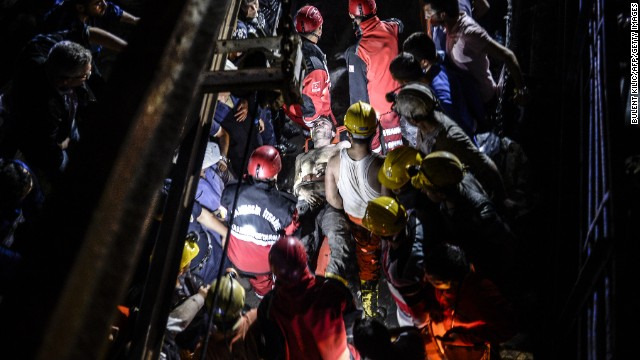 An injured miner is carried out by rescue workers on May 13. The mine shaft is about two-thirds of a mile -- or 1 kilometer -- underground, a disaster agency said.