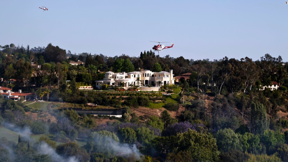 A wildfire threatens luxury homes in the Fairbanks Ranch area on May 13.