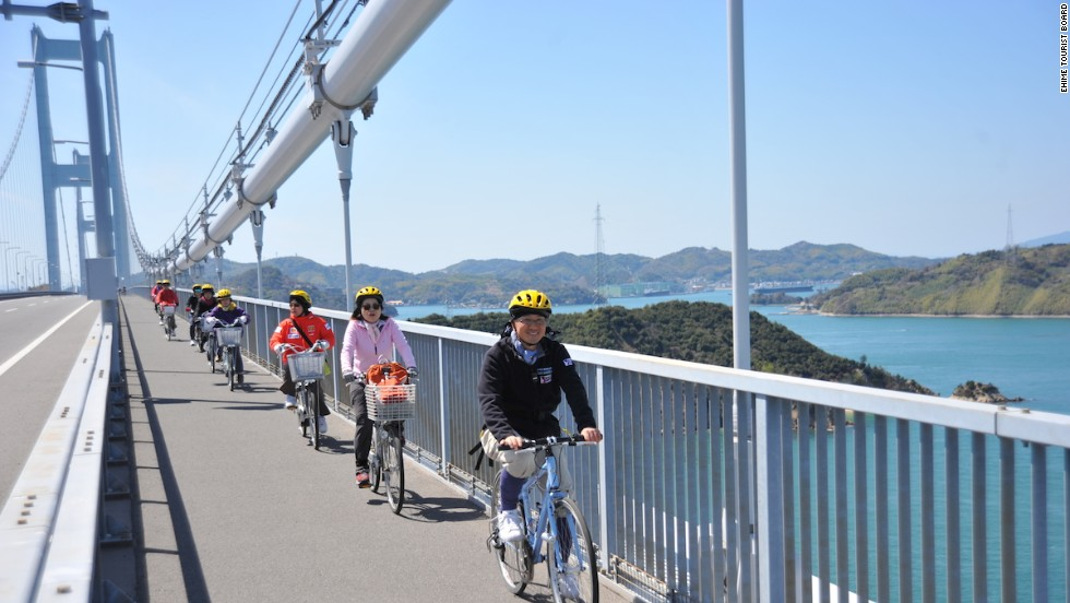 Happiness is a designated cycle lane, like this beauty stretching across Shimanami Kaido's Kurushima Bridge.