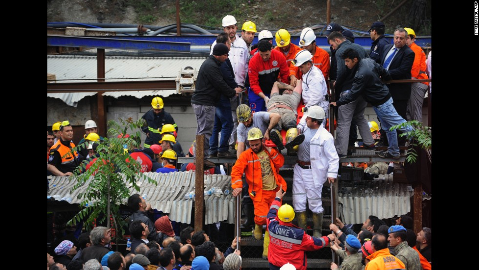 Rescue workers carry a miner to an ambulance on May 14.
