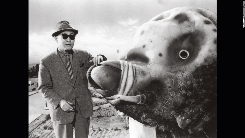 "Tsuburaya and the 33-foot Mothra ""costume"" in 1961. Note the detailed miniature fields in the background."