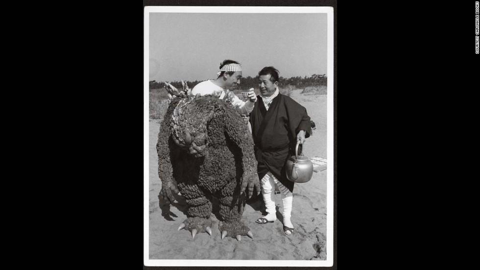 """Katsumi Tezuka offers a drink to Haruto Nakajima, left, while filming the U.S. version of """"Mothra vs. Godzilla."""""""