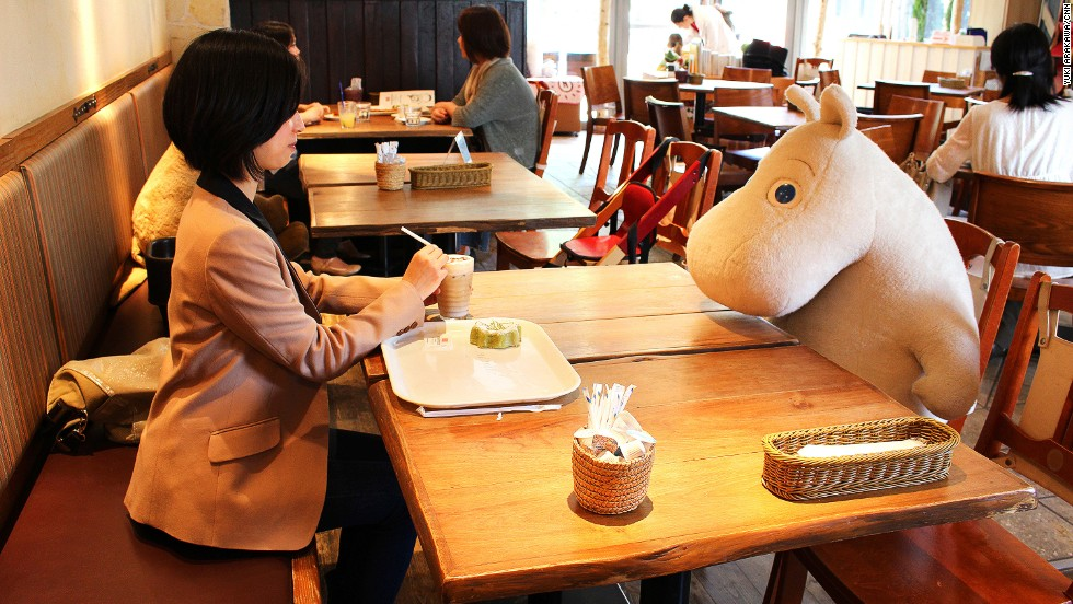 At Tokyo's Moomin House Cafe, lone patrons are seated with a plush toy for company.