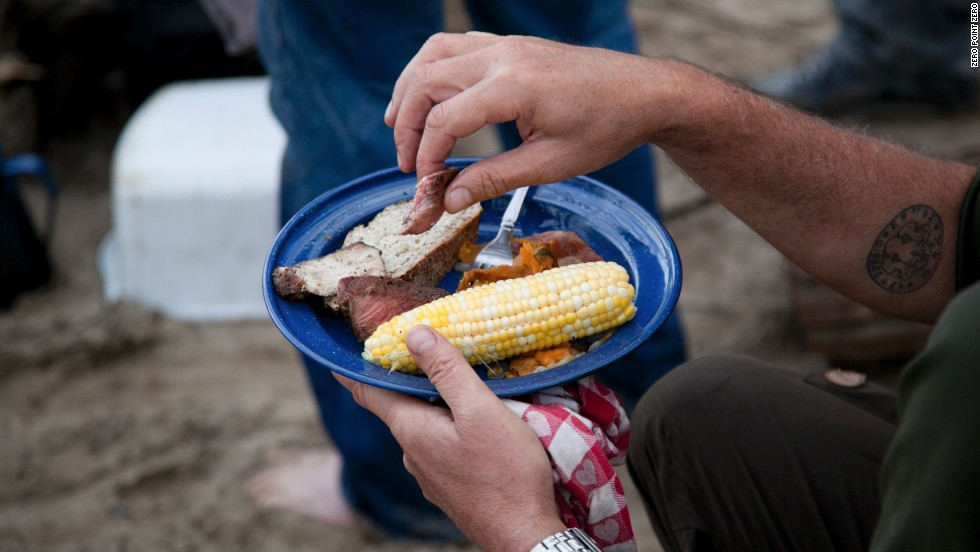 Tony's campfire lunch of grilled meat, corn and sweet potatoes.