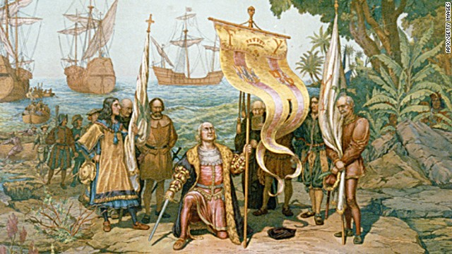 Christophe Colomb agenouille, avec la baniere et l'epee sur l'ile de San Salvador, sur la mer on voit les caravelles Pinta, Nina, Santa Maria, illustration (19e siecle)  --- Christopher Columbus kneeling, holding flag and sword with two other men holding flags. There are other men on land and in boats behind Columbus and three ships in background. On the island named San Salvador by Columbus, later called Watling Island., illustration (19th century)