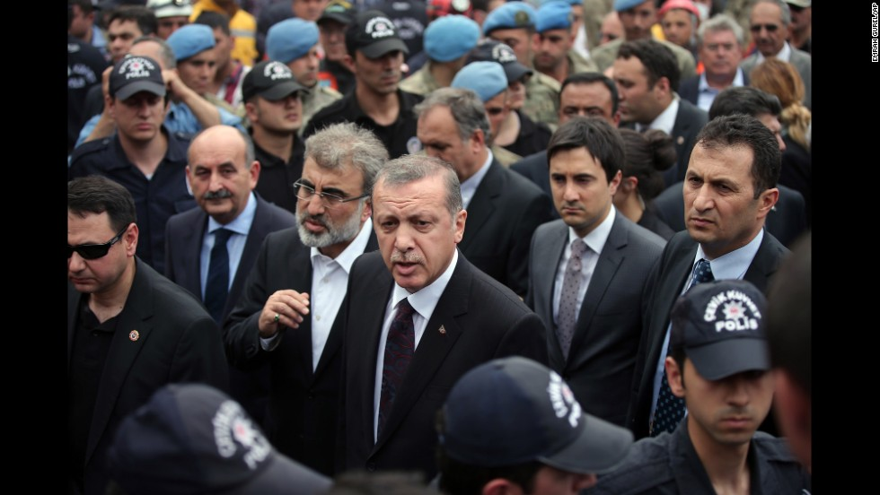 Turkish Prime Minister Recep Tayyip Erdogan, center, surrounded by security, visits the coal mine on May 14. Hundreds have taken to the streets of Istanbul and Ankara since the disaster in protest of the government and poor safety regulations. Unions have called for strikes across the country on May 15.