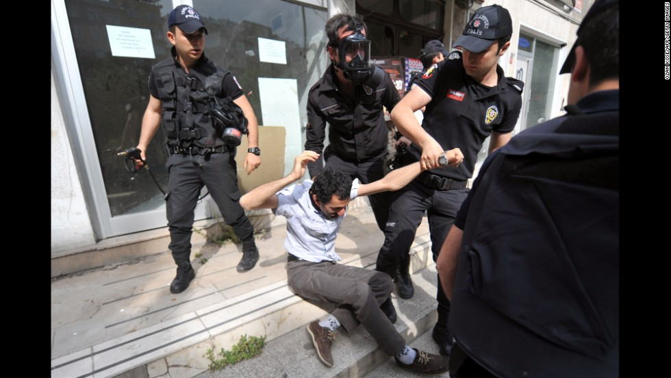 A protester is detained in front of the General Directorate of Mineral Research and Exploration headquarters in Istanbul on May 14.