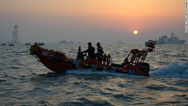 Coastguard boats and search and rescue teams take part in recovery operations at the site of the 'Sewol' ferry of the coast of the South Korean island on Jindo on April 22, 2014.