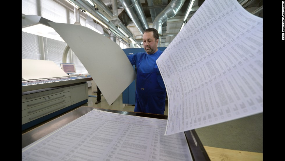 A man examines ballots at a printing house in Kiev, Ukraine, on Wednesday, May 14. The ballots will be used in early presidential voting on May 25.