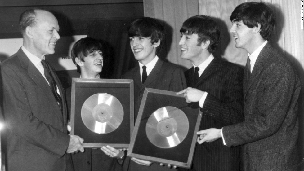 "The Beatles released their first album, ""Please Please Me,"" in the United Kingdom on March 22, 1963. Here, the band is honored on November 18, 1963, for the massive sales of albums ""Please Please Me"" and ""With the Beatles."""