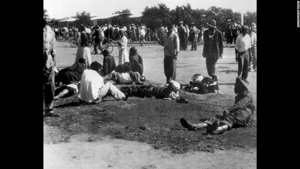 Wounded people in South Africa's Sharpeville township lie in the street on March 21, 1960, after police opened fire on black demonstrators marching against the country's segregation system known as apartheid. At least 180 black Africans, most of them women and children, were injured and 69 were killed in the Sharpeville massacre that signaled the start of armed resistance against apartheid.