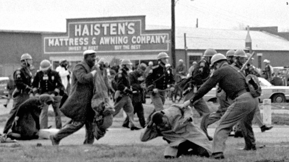 "State troopers swing batons to break up a civil rights voting march in Selma, Alabama, on March 7, 1965. <a href=""http://www.cnn.com/2010/US/03/07/selma.march.anniversary/"">""Bloody Sunday,"" as it became known</a>, helped fuel the drive for passage of the Voting Rights Act of 1965."