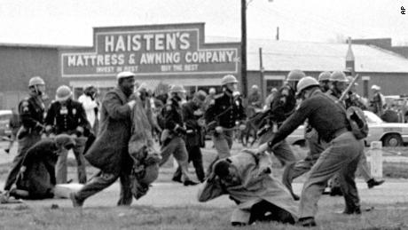 State troopers swing billy clubs to break up a civil rights voting march in Selma, Ala., March 7, 1965. John Lewis, chairman of the Student Nonviolent Coordinating Committee (in the foreground) is being beaten by state troopers. (AP Photo)