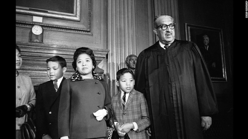 Supreme Court Justice Thurgood Marshall, with his family at his side, takes his seat at the court for the first time on October 2, 1967. Marshall was the first African-American to be appointed to the high court.