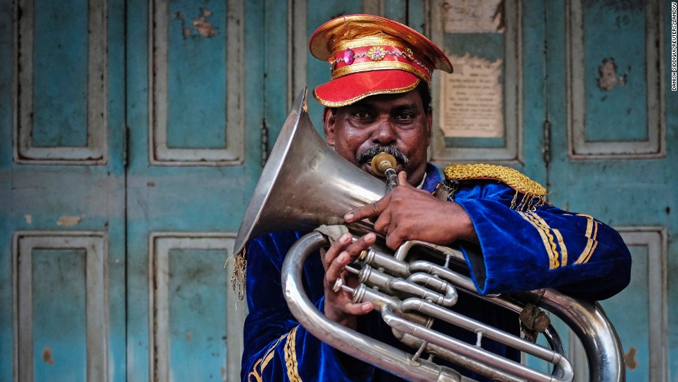 A member of a local band plays his instrument during a marriage ceremony in Mumbai, India, on Sunday, May 11.
