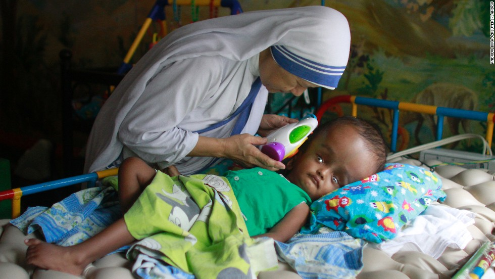Sister Maricor from the Missionaries of Charity spends a moment with John, a 1-year-old with hydrocephalus, at an orphanage in Dhaka, Bangladesh, on Mother's Day, Sunday, May 11. Hydrocephalus is characterized by an excessive accumulation of fluid in the brain.