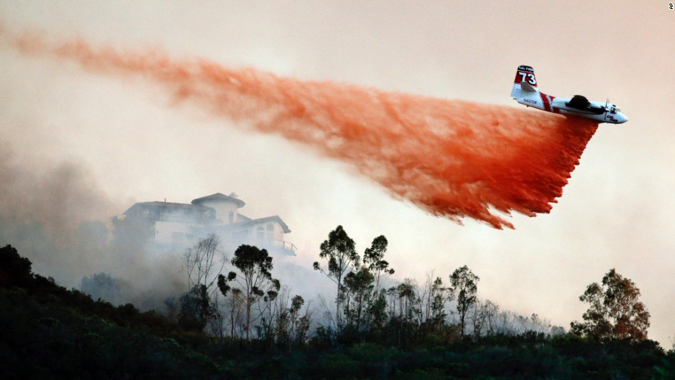 "A plane drops fire retardant over a wildfire hot spot in San Marcos, California, on Wednesday, May 14. About 10,000 acres <a href=""http://www.cnn.com/2014/05/13/us/gallery/california-wildfire/index.html"">have already been charred</a> in San Diego County."