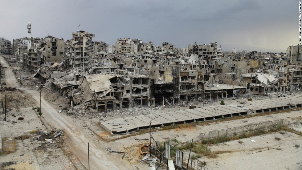 Buildings in Homs, Syria, lie in ruins Saturday, May 10, days after an evacuation truce went into effect. Thousands of displaced residents returned to the city.