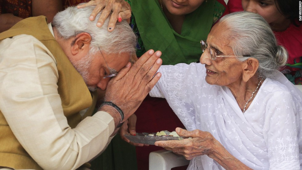 Hiraben Modi, 90, blesses her son Narendra, who becomes India's next prime minister, at her home in Gandhinagar on May 16. Analysts predict his arrival in India's top office will bring a marked change in direction for the world's most populous democracy.