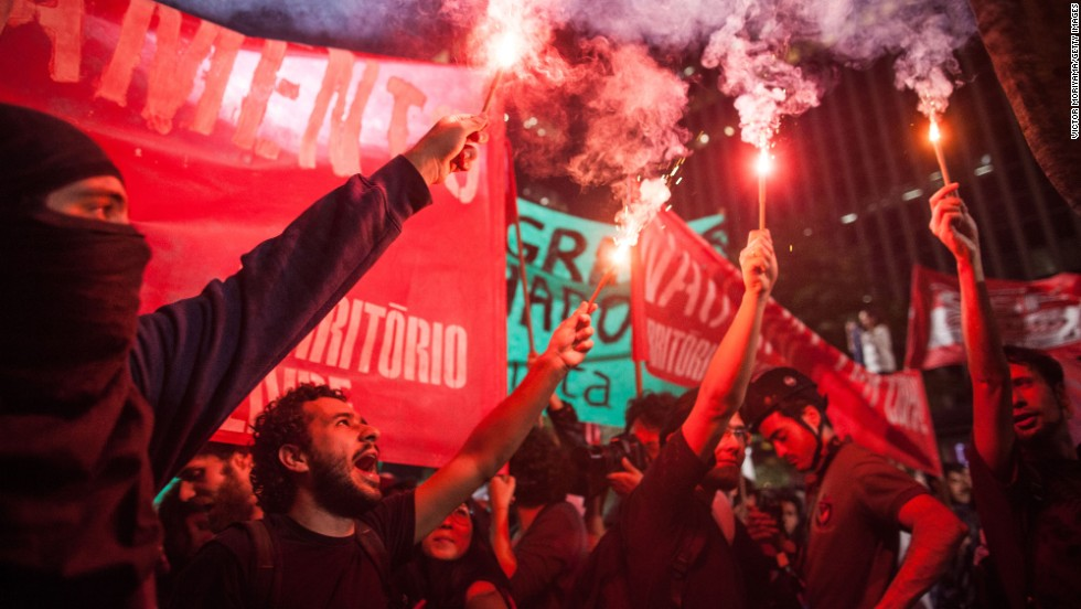 Protesters burn flares in the streets of Sao Paulo on May 15.
