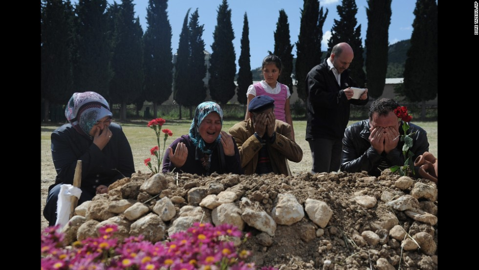 Family members mourn at the grave of a victim on May 16.