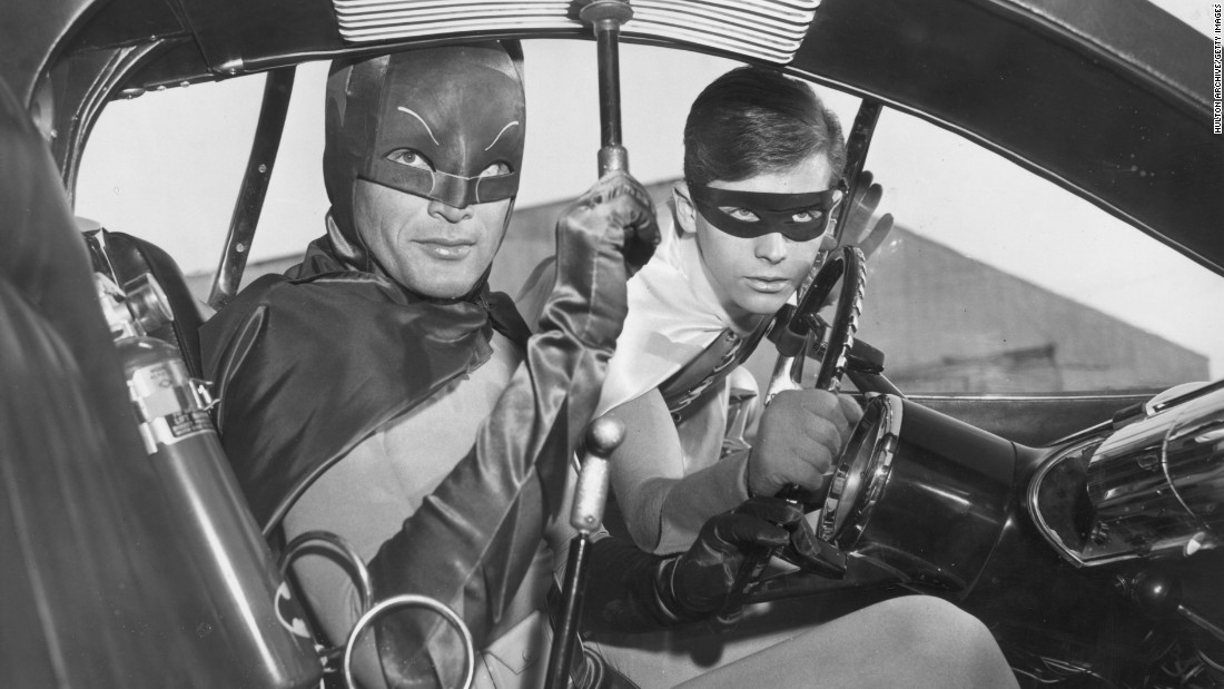 "Adam West, left, and Burt Ward portrayed the Dynamic Duo in the wildly popular 1960s TV series ""Batman."" Click through to see other actors who have played the Caped Crusader of Gotham City."