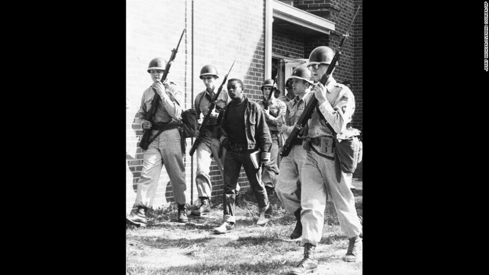 National Guardsmen escort a black student from high school in Sturgis, Kentucky, at the end of a school day in September 1956.