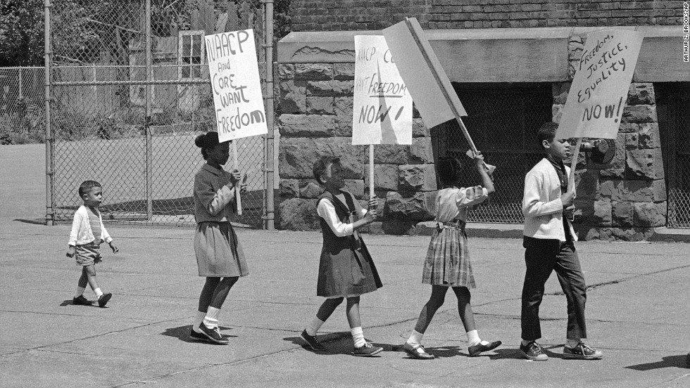 Ten years after the Supreme Court's decision, protests were still taking place. Here, 2-year-old Prentice Sharpe joins older children picketing a predominantly black elementary school in Albany, New York, on May 18, 1964.